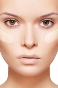 Skin care & cosmetics. Woman applying skin tone foundation