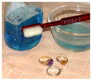 cleaning-jewelry-with-toothbrush-and-detergent