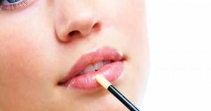 Stock-photo-of-woman-applying-lipgloss